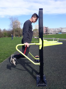 A man works out in an outdoor gym